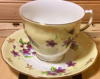 Yellow and Violets Queen Anne Footed Teacup and Saucer