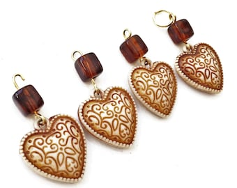 craft lot destash of salvaged rust and beige hollow acrylic heart and bead dangles--matching lot of 4