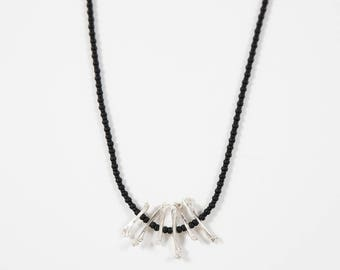 Matte black beaded necklace with sterling silver bone beads // cast bone jewelry