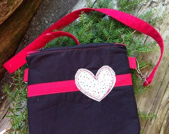 Black bag with heart applique crossbody bag