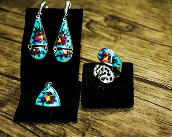 Set from earrings, rings and a pendant