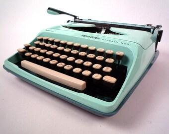 Aqua Remington Streamliner manual typewriter, with case