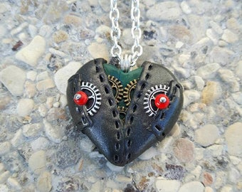 Blue with pockets made of polymer clay steampunk Heart Necklace.
