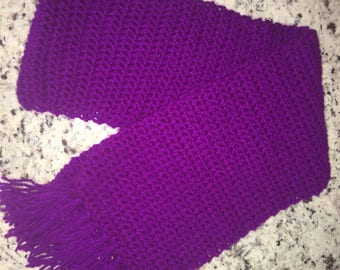Purple crocheted scarf with fringe