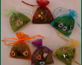 Bags of smelling herbs to scent linens and beads embroidered cabinets