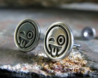 Tounge out winking emoji sterling silver stud earrings. Zany posts. Funny social media gift. Gag pop culture jewelry. Cute little earrings.
