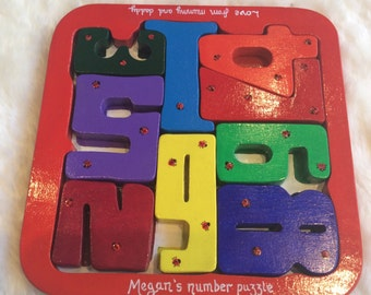 Hand painted wooden ladybird  number puzzle