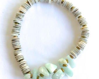Wanderer bracelet: shell disc and aquamarine stretch stack bracelet
