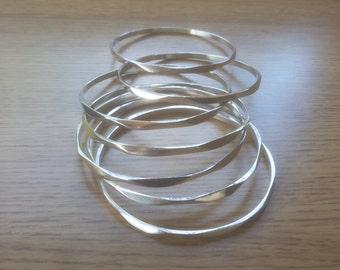 Set Of Seven Bright Silver Bangle bracelets