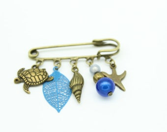 Bronze leaf brooch filigree blue and sea charms