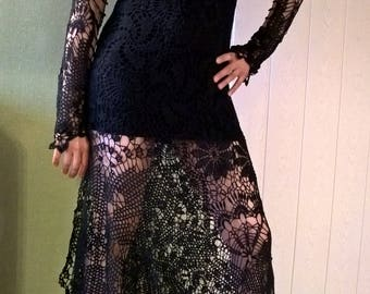 The dress is crocheted. Irish lace, knitting.