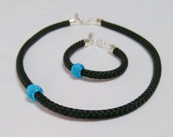 Handmade jewelery set.  Necklace and bracelet with black nautical rope , and blue metalic bead.
