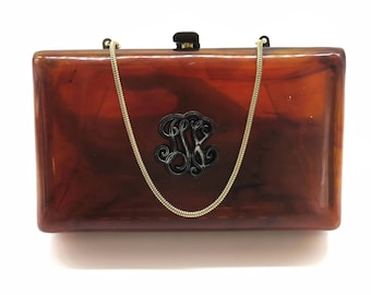 Vintage tortoiseshell Lucite box purse with decorative feature on front, handle, brass catch, plastic sides, circa mid 20th century