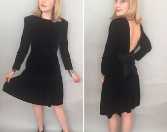 Small 1980s black velvet dress with giant bow