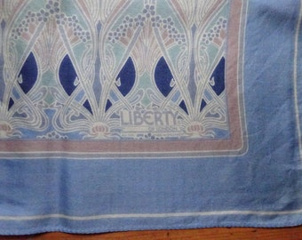 Liberty of London iconic Ianthe print scarf.  Pale blue silk with beige, pinks and darker blue highlights.  59 cm square
