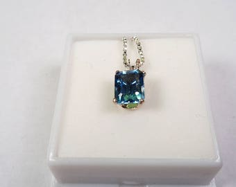 London Blue Topaz Necklace.  Natural 8 x 6mm. London Blue Topaz Silver Pendant on a 24 inch Chain.