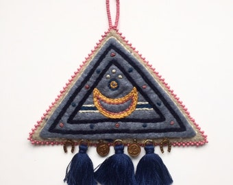 Hand Embroidered Talisman. Crescent Moon with Tassels and Charms. Blended felt wall hanging. Triangle, witch, symbolism. 5 1/4 x 5 3/4
