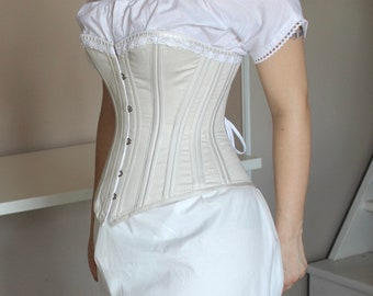 1860 Victorian cotton corset and metal splints, with lace casing.