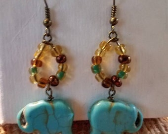 Free shipping. Turquoise elephant charm with glass beads dangle earrings