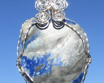 Blue  Aventurine,  cabochon pendent,  wrapped in  Argentium  silver wire.