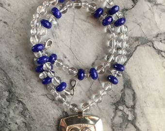 Infinity Symbol  with Quartz Crystal and  Blue Adventurine Beads.