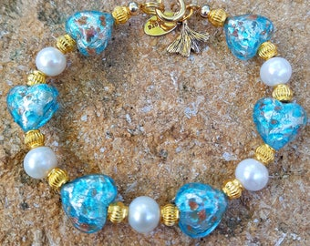 Murano glass beads bracelet, opaque aqua blue glass hearts with gold foil and Aventurine, and white freshwater pearls.