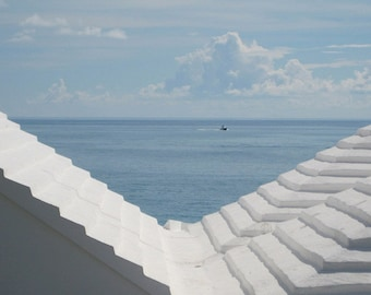 White Rooftops II - Blue & White Bermuda Seascape - Classic Bermudian Stepped Rooftop - Original Color Photograph by Suzanne MacCrone Rogers