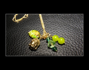 18K Gold plated necklace with peridot and Semi sediment Jasper Swarovski crystal beads and a 18K gold-plated Buddha Pendant