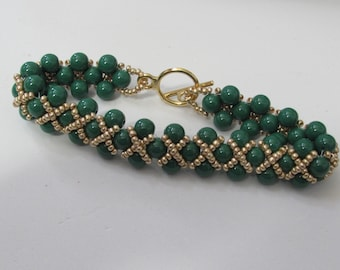 Green Bead Bracelet with Gold Bead Embellishments and Gold Plated Toggle Clasp