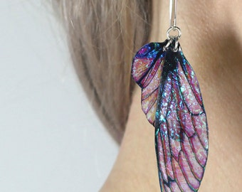 Large sugar plum faerie wing earrings. Deep pink iridescent fairy wings on handmade sterling silver ear wires. Magical faery fae jewellery.