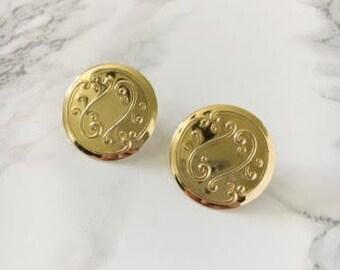 swirl disc earrings