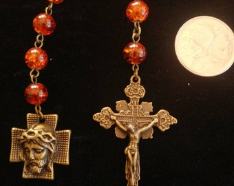Red and antiqued bronze pocket rosary