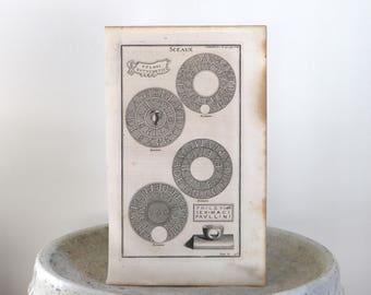 1719 Antique Engraving Ancient Seals Crests Paris 1719 9 1/4 x 15 inches