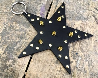 Spanking Star available in black leather and glow in the dark leather with gold or silver coloured spikes and rivets - free UK Delivery