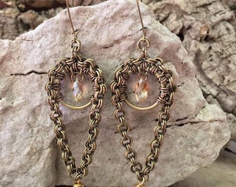 Pendant earrings with faceted glass drop.