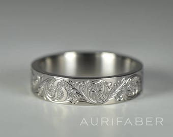 Hand engraved titanium ring. Handmade titanium scroll ring with hand engraved ornament. Nature inspired scroll design ornament.