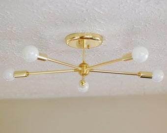 Mid-century modern chandelier 5-arm sputnik style with plated brass finish
