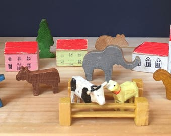 Collection of vintage Erzgebirge miniature wooden animals and buildings, vintage wood toys, German folk art, toy farm