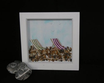 Deck chairs on the pebbles