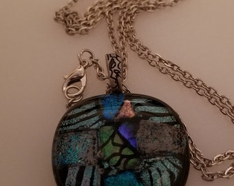 Greenish dichroic glass fused on black base with chain