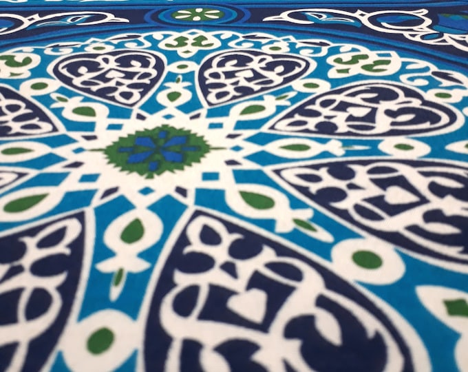 Traditional blue Egyptian cotton tablecloth. Mandala and arabesque patterns. Festive table decoration. Tablecloth for outdoor table