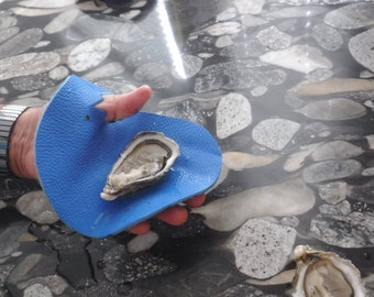 Protective leather handle to open oysters and shells