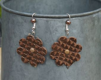 Made with a brown leather flower stud earrings and matching beads