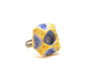 Carved blue and gold square ring