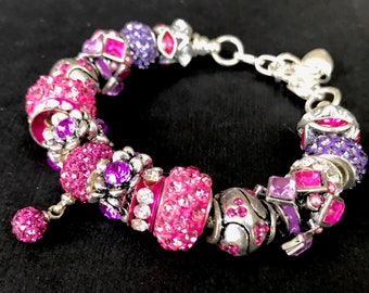 Fuschia and purple crystal charm bracelet.