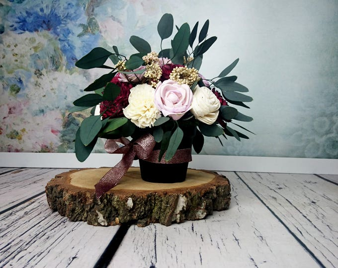 Wedding floral arrangement table centerpiece sola flowers stabilized eucalyptus rice flower fall burgundy lilac lavender ivory natural