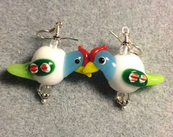 White, turquoise, and green lampwork chicken bead earrings adorned with clear Czech glass beads.