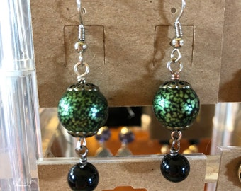 Green and black speckled ball earrings with onyx beads