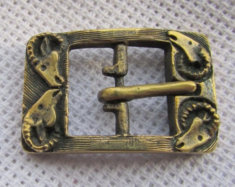 Buckle bracelet on sheep. Scythian style. Bronze