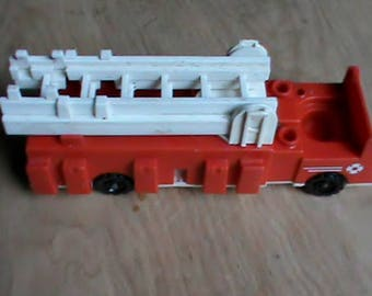 Vintage Fisher Price Little People toy Fire Truck with extension ladder.